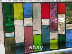 Stained glass panel with bevels and rainbow colors